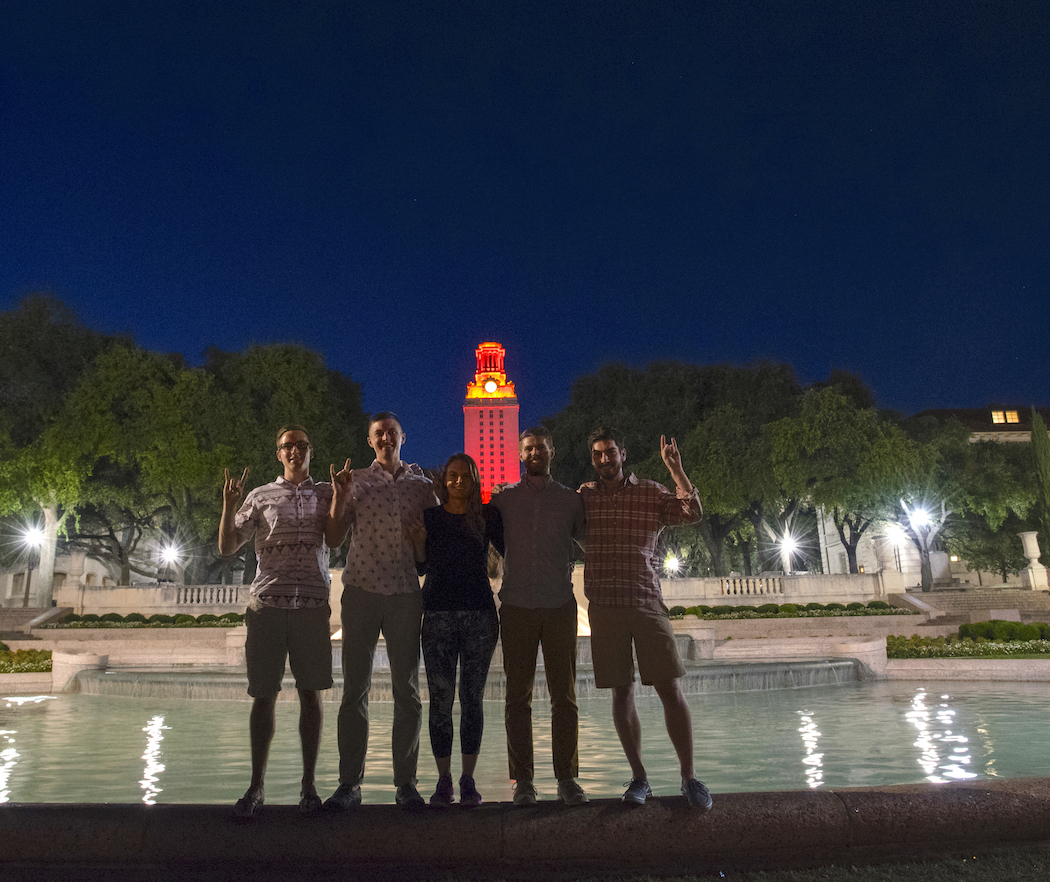 Students Pose Beneath UT Tower