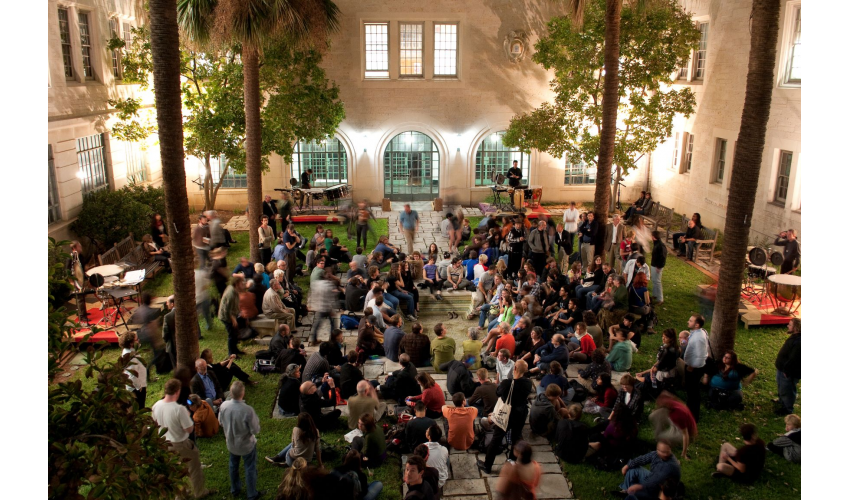 Students gathering in the Goldsmith Courtyard at night