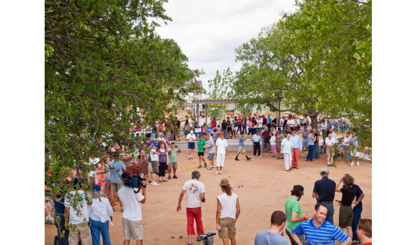 Outdoor plaza with trees and many people