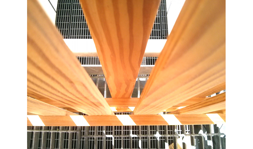 View from underneath wooden slats with sunlight shining through