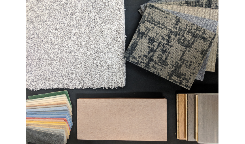 Close-up of selected carpeting and plaster materials on a black background