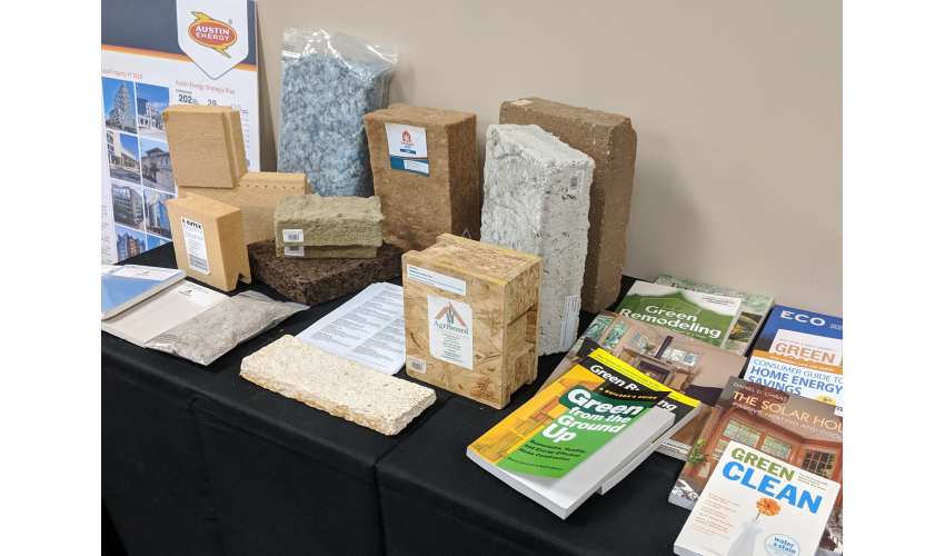 Table showcasing material selections for structural and insulation components. Books pictured were provided by Austin Energy.