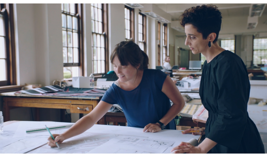 Tamie Glass in studio with a student