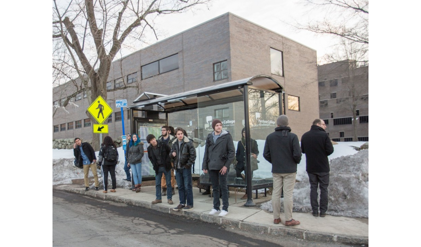 Image of crowded bus stop
