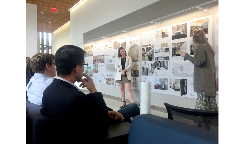 Students Ana Berthelsen and Alexandra Wilkinson present their final design to a panel of reviewers at Dell Medical