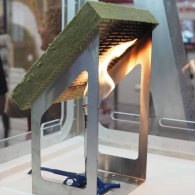 Image of a piece of Rockwool on top of a fire source showing the product's resistance to fire.