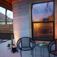 A close-up image of ICON's first permitted 3D-printed home in the US.