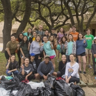 UT Austin Students Post with Trash Bags at Waller Creek