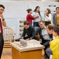 Student engaging with reviewers during architecture final review