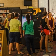 People gather round The Stacks at the unveiling at the Carver Branch Library