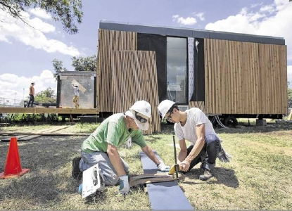 students working on solar house