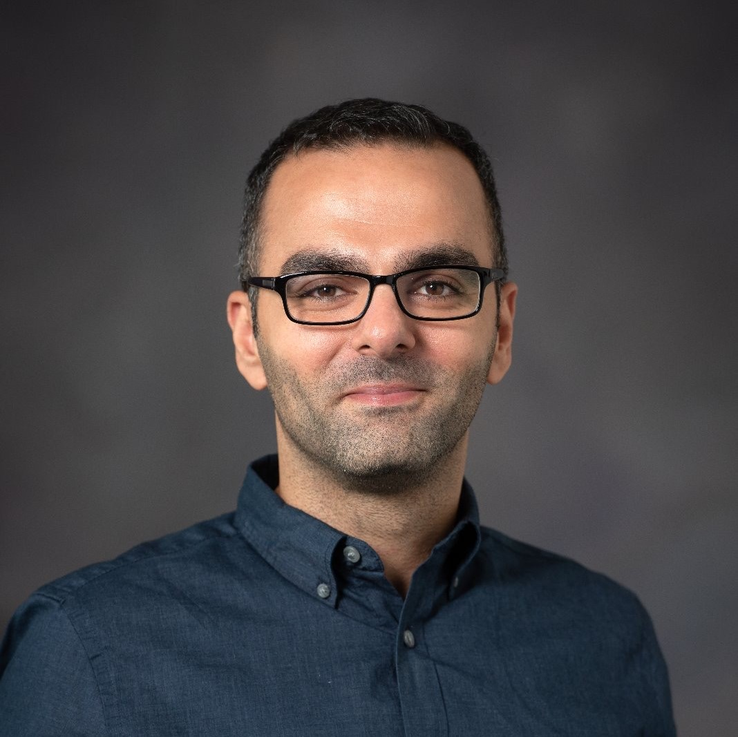 Color headshot of Interior Design alumnus George Fares against a neutral background