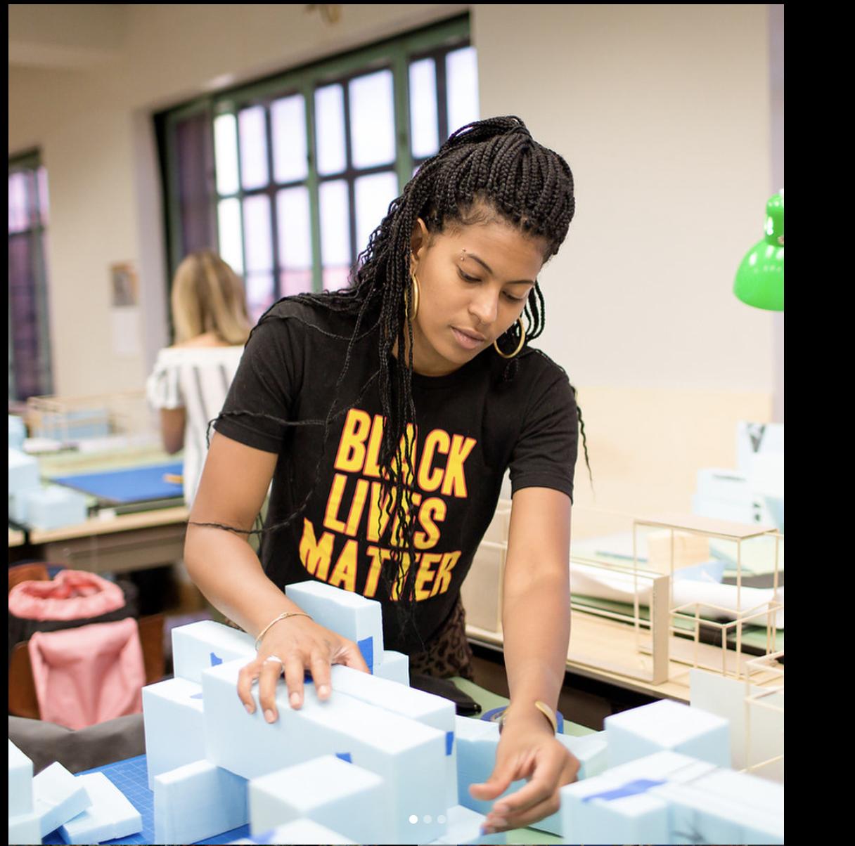 Taylor Davis working in studio wearing a Black Lives Matter shirt