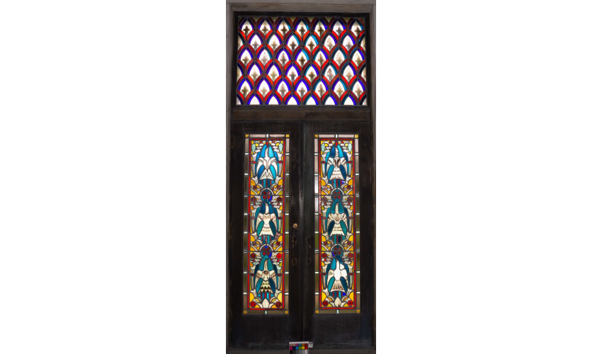 Image of Window 46 by Edgar Miller. The lower two panels are set into a double metal door with a thrid, transom panel above. View facing west. Window captured in transmitted light.