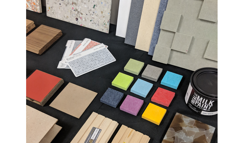 Close up of interior finishes selected for the exhibition on a black background.