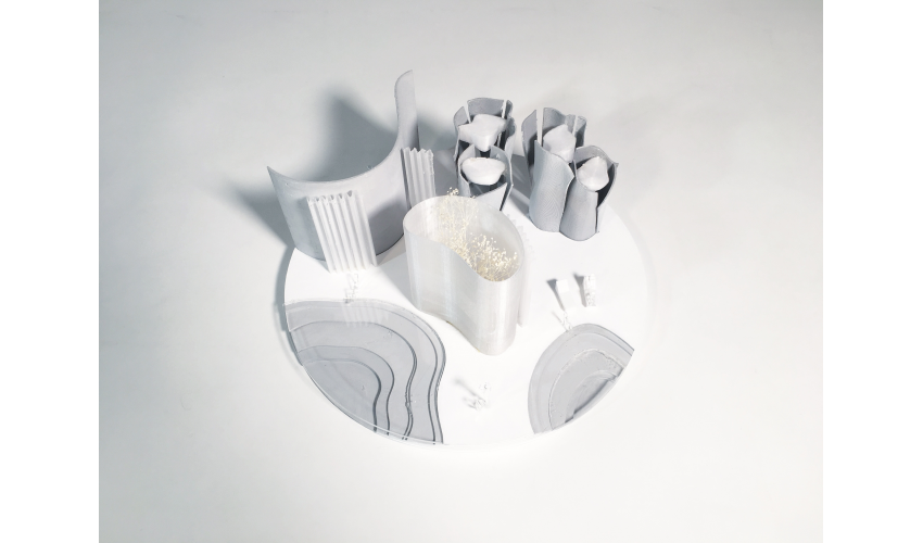 Overhead shot of a student's model of a bathhouse, made of paraffin