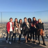 Students in the Ampersand Interior Design student group pose on top of a building
