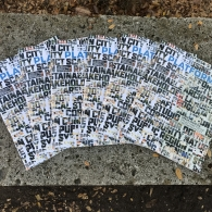 Multiple copies of PLATFORM 2020-21 laid out artfully atop a concrete bench on UT Austin's campus