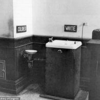 """A black and white image of """"colored"""" and """"white"""" water fountains next to one another"""