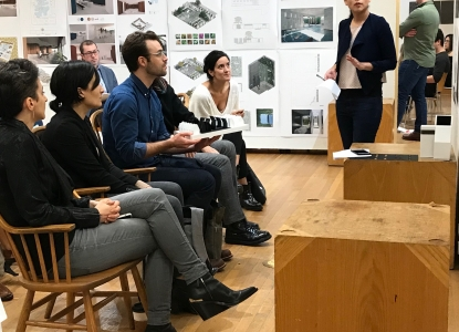 Nerea Feliz engaging with a student during their final review presentation in Fall 2019